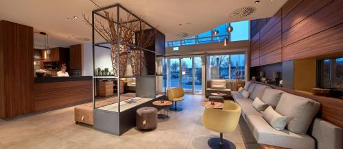 The lounge or bar area at Sachsenpark-Hotel