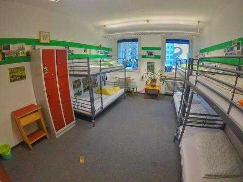 A bunk bed or bunk beds in a room at Black Sheep Hostel