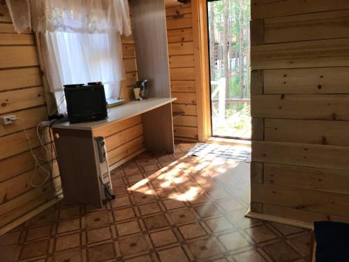 Телевизор и/или развлекательный центр в Bagulnik Guesthouse