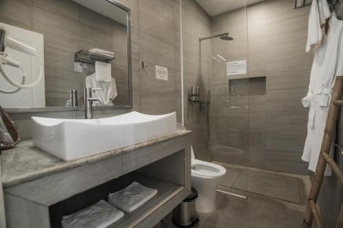 A bathroom at White Boutique Hotel and Residences
