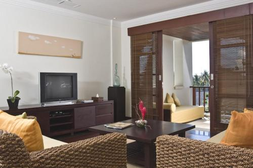 A television and/or entertainment centre at Apartment Nusa Dua