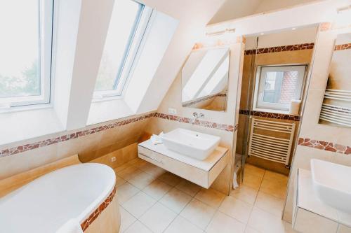 Ein Badezimmer in der Unterkunft Strandpension Mäder