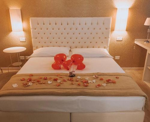 A bed or beds in a room at Nuova Opera Rooms