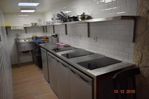 A kitchen or kitchenette at Hostel Lyonnais