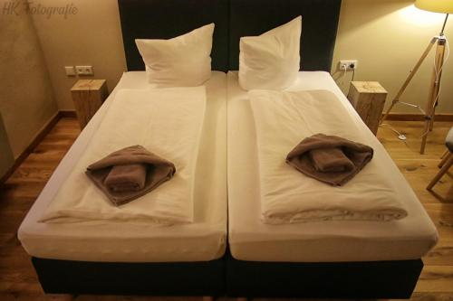 A bed or beds in a room at Hostel & Hotel Samocca