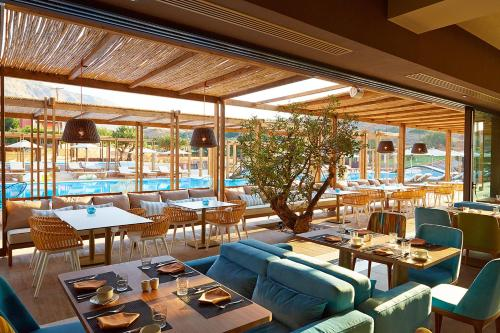 A restaurant or other place to eat at Domes of Elounda, Autograph Collection