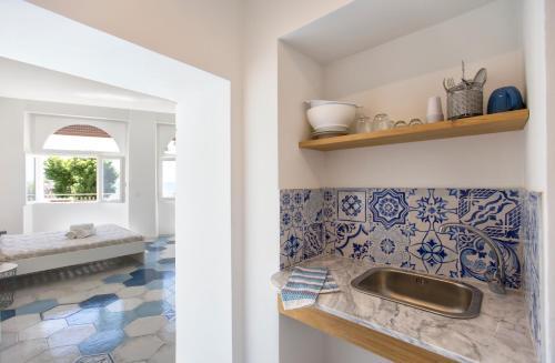 A kitchen or kitchenette at Ciutat Alghero