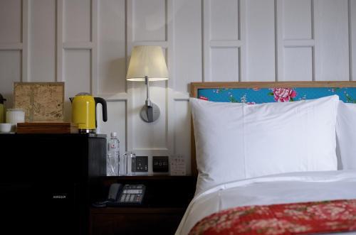 紅點文旅房間的床