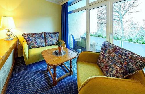 Ein Sitzbereich in der Unterkunft Hotel Reiterhof