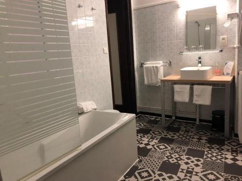 A bathroom at Hôtel De La Loge