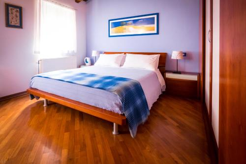 Кровать или кровати в номере Achillea B&B