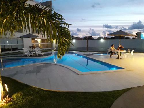 The swimming pool at or close to Apartamento na praia do francês