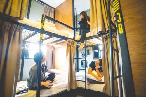 A bunk bed or bunk beds in a room at Traveller Bunker Hostel 1
