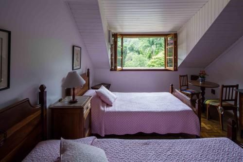 A bed or beds in a room at Pousada da Alcobaça