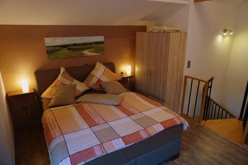 Ein Bett oder Betten in einem Zimmer der Unterkunft Ferienwohnung Familie Westermann