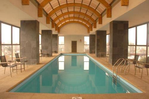 The swimming pool at or near Santiago Suite Apartment