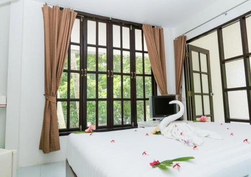 Ein Bett oder Betten in einem Zimmer der Unterkunft White House Bailan Resort