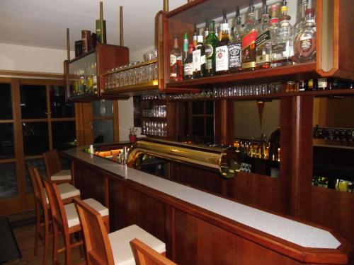 The lounge or bar area at Alphotel Ettal