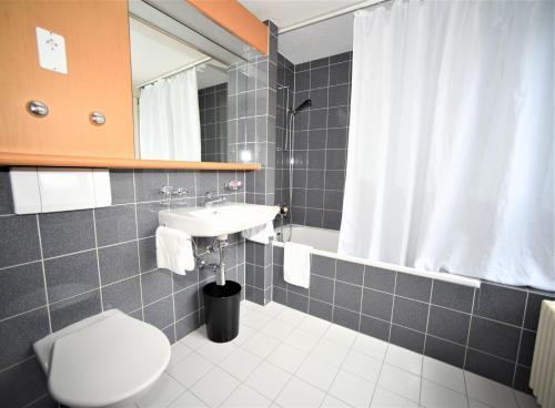 Ванная комната в Hotel Limmathof