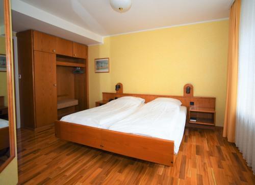 Кровать или кровати в номере Hotel Limmathof