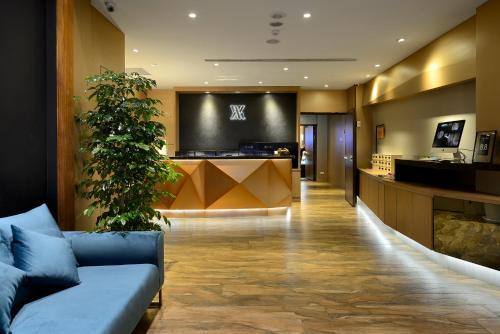 The lobby or reception area at Via Hotel Taipei Station