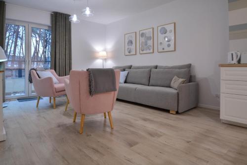 A seating area at Apartamenty Cesarskie - Bryza