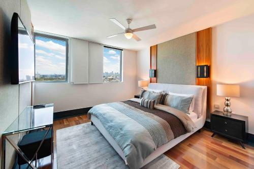 A bed or beds in a room at 2 Bedroom Oceanview Private Residence at The Setai - 2704