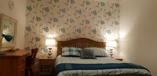 A bed or beds in a room at Meldrum Arms Hotel