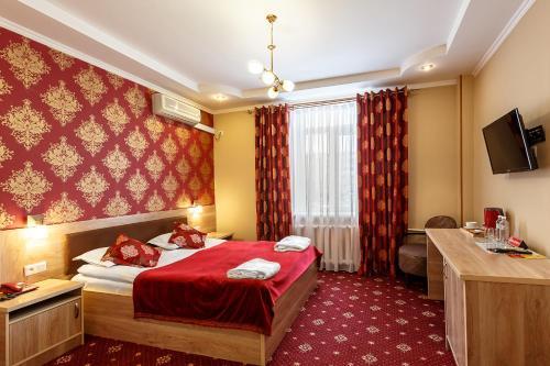 Cama o camas de una habitación en Renion Zyliha Hotel