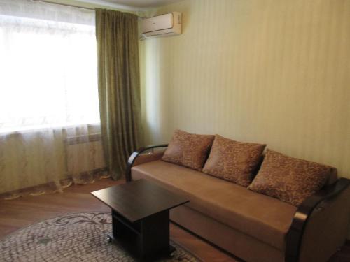 Гостиная зона в Apartment on Vladimira Nevskogo 38g
