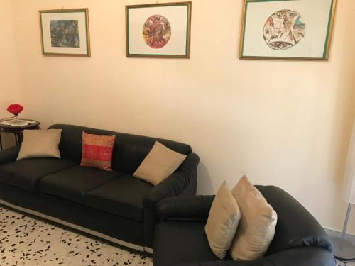 A seating area at Casa Vacanze il Pepe Rosa