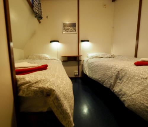 Ein Bett oder Betten in einem Zimmer der Unterkunft Hotelboat Sarah