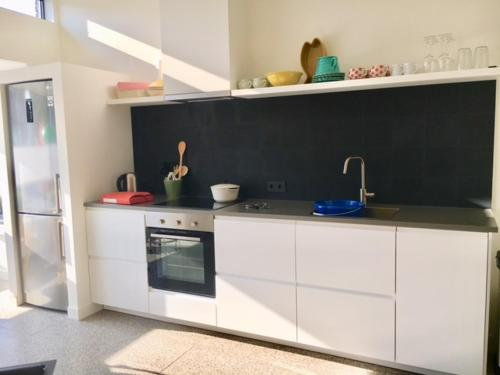 A kitchen or kitchenette at Inpetto-Inn