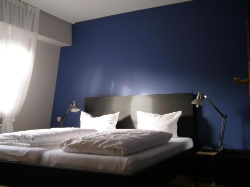 Ein Bett oder Betten in einem Zimmer der Unterkunft Park-Villa