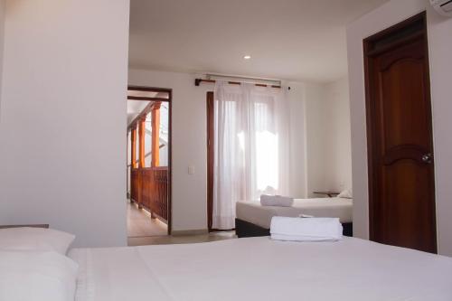 Cama o camas de una habitación en Akel House Hotel