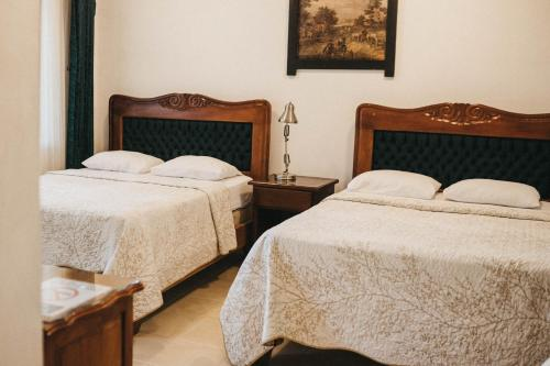 A bed or beds in a room at Hotel Javy