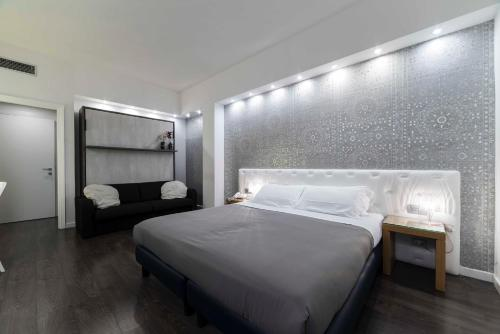 A bed or beds in a room at Hotel Montestella