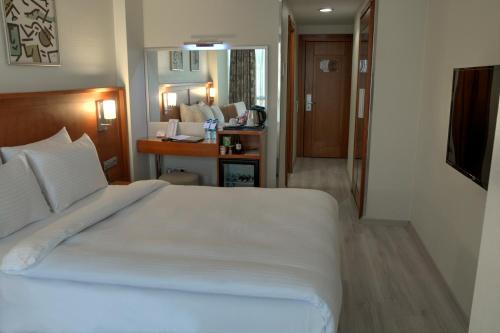 A bed or beds in a room at Orka Royal Hotel & Spa