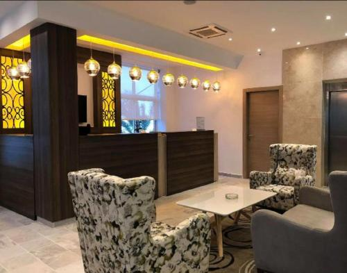 The lobby or reception area at Hotel Rym El Djamil