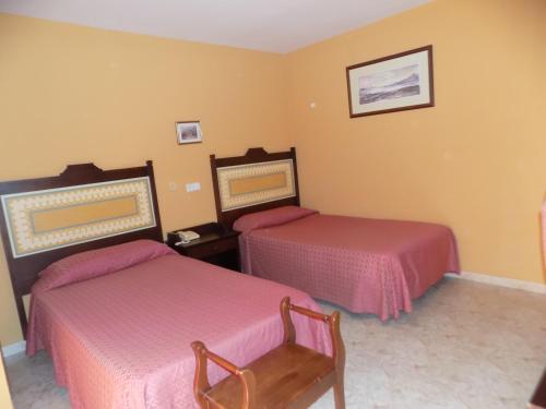 Cama o camas de una habitación en Hotel Braseria La Barca