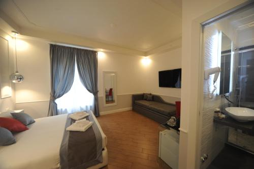 A television and/or entertainment center at My Suites Piazza di Spagna
