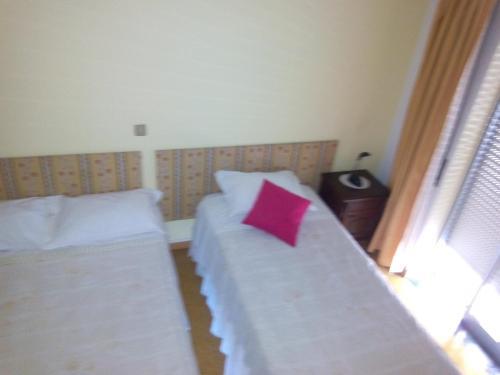 Uma cama ou camas num quarto em Pereira Guesthouse