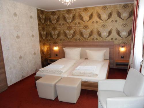 Кровать или кровати в номере Landhotel Fuchsbau