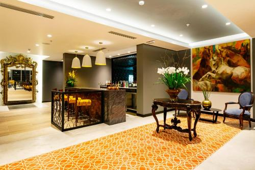 The lobby or reception area at Mercure Ariosto Lima