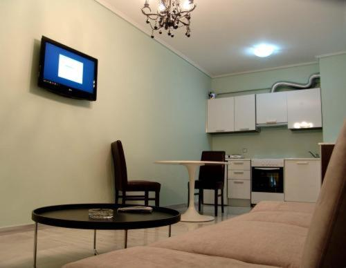 A television and/or entertainment centre at Art Suites Athens