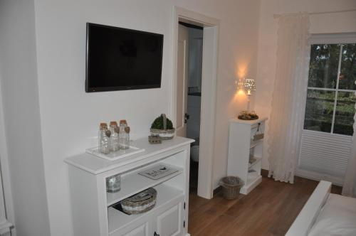 A television and/or entertainment center at White Cottage Garden
