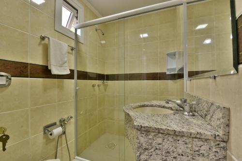 Um banheiro em Hotel Pequeno Bosque