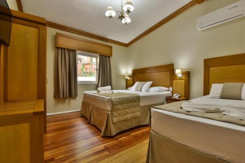 Cama ou camas em um quarto em Hotel Pequeno Bosque