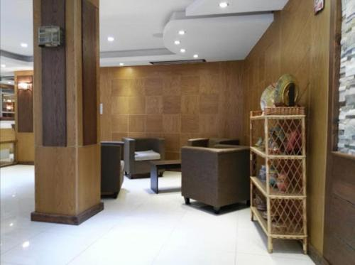 The lobby or reception area at Assala Hotel