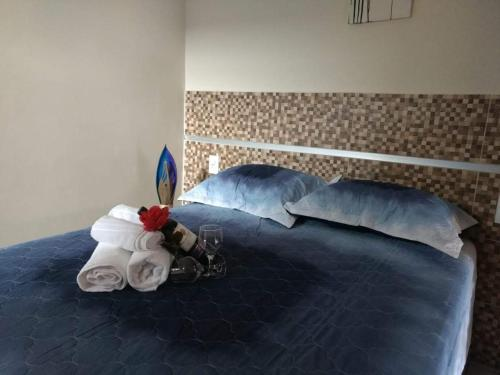 A bed or beds in a room at Pousada Praias do Gostoso
